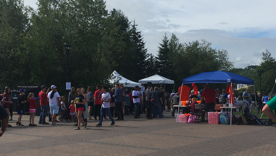 A Labor Day crowd mills around at Bayfront Park in Duluth on Labor Day 2019.